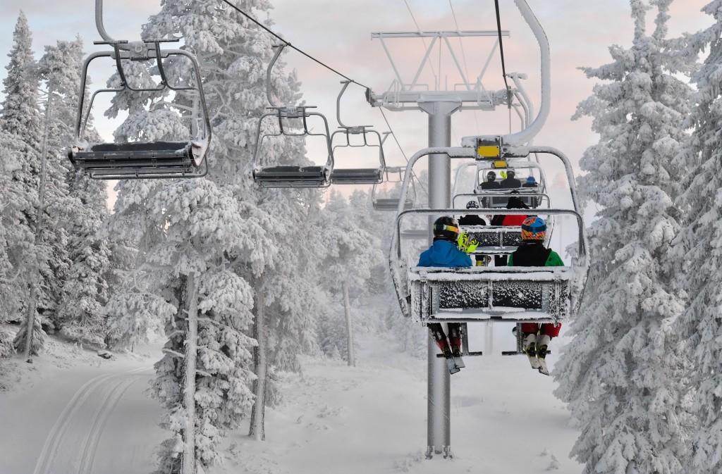 Ski chair lift with skiers. Ski resort in Ruka, Finland
