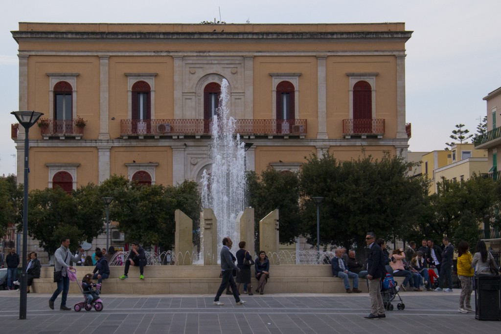 Crowds gather in Piazza Vittorio Emanuele Monopoli in Puglia, Italy